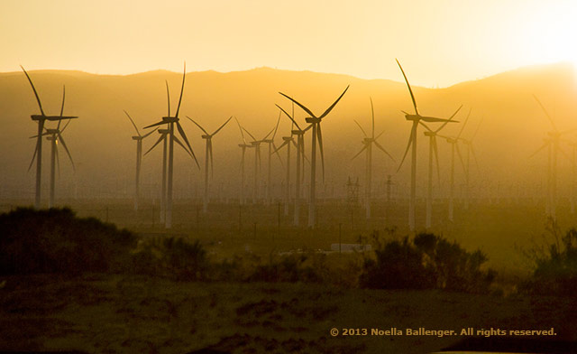 Photo of a wind farm in Mojave, California made at sunrise using a fast shutter speed by Noella Ballenger.