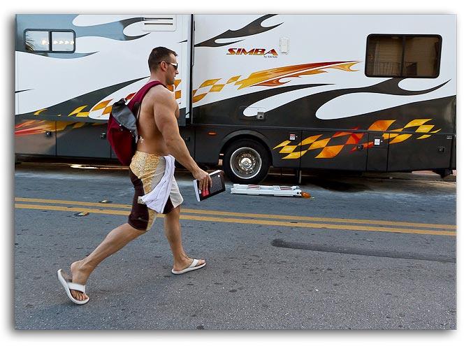 Photo of man walking to beach at South Beach, Miami, Florida by Jim Austin