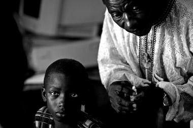 Photo portraid of Haddi at eye clinic, Ghana, Africa by Marielle van Uitert
