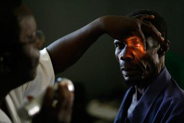 Photo portraid of Isa getting eye exam, Ghana, Africa by Marielle van Uitert