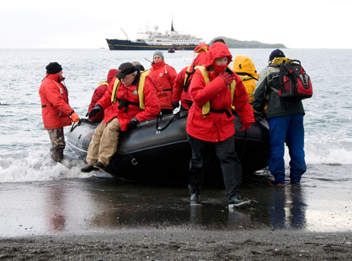 Photo of travelers on Zodiac raft at Salisbury Plain, Antarctica by Cliff Kolber