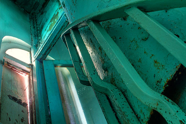 HDR image: The green Great Stirrup Lighthouse bannister and upper doorway in the Bahamas by Jim Austin.