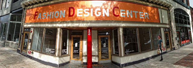 Downtown storefront captured with a smartphone camera in panorama mode by Allen Moore.