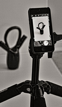Image of smartphone mounted on a tripod in a studio setting by Allen Moore.