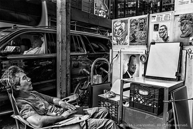 Black and white image of an artist sleeping near his work and a man sleeping in his car on the street in New York City by Luca Venturi.