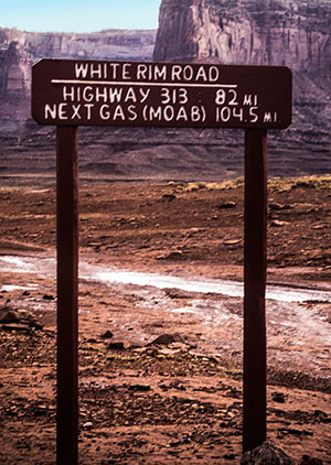 Sign in canyonlands in Utah saying how many miles to the next gas station by Noella Ballenger.