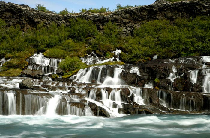 Photo of waterfalls at Hraunfoss in Iceland by Andy Long
