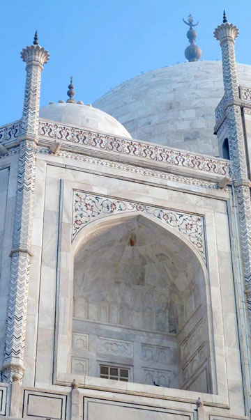 Photo of the in-laid flowers and Koranic scripture on Taj Mahal by Rick Clark