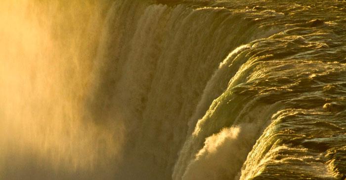 Image of golden light of dawn at Niagara Falls overlooking Horseshoe Falls, Ontario, Canada by Noella Ballenger.