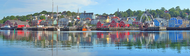 Reflection on water of the colorful building at the Lunenberg Harbor in Nova Scotia, Canada by Jim Autin.