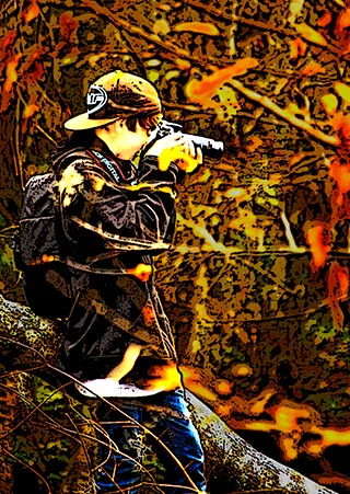 Image of young man making photos in the woods by Marla Meier.