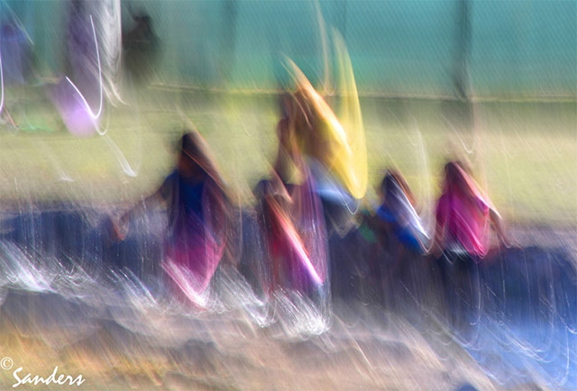 Photo Impressionism technique: image of people in a park using camera shake and oversaturated color to create an impressionistic effect by Gerald Sanders.