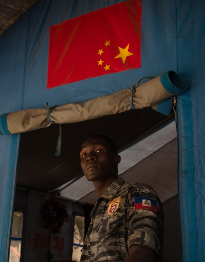 Photo of a member of the Haitian police force stationed in the tent city of Cite Soleil by Michelle Wong