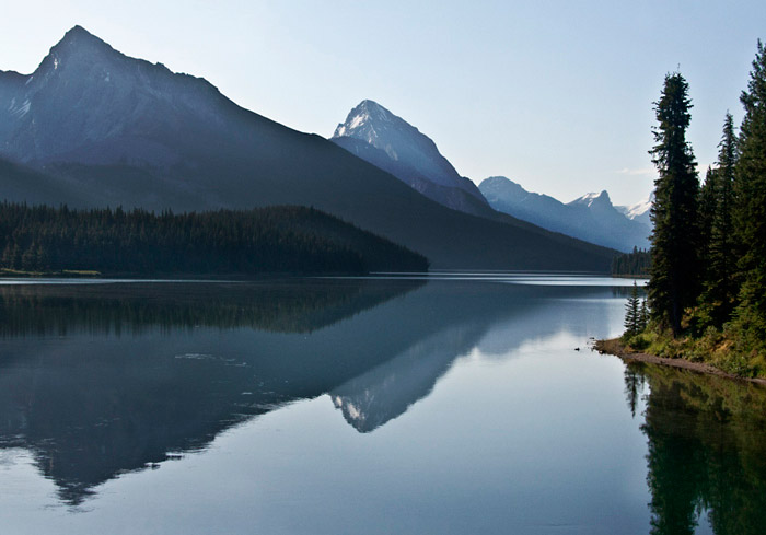 Landscape reflection photo of mountain range and lake in Maligne Lake, Alberta, Canada by Noella Ballenge