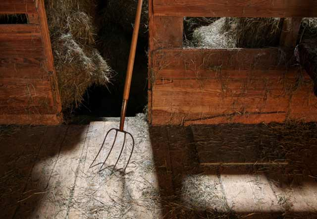 Photographing Historial Place: Pitchfork and hay inside the barn at Kuerner Farm by Gary Anthes.