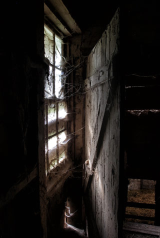 Photographing Historial Place: Window and window light on a door inside the barn at Kuerner Farm by Gary Anthes.