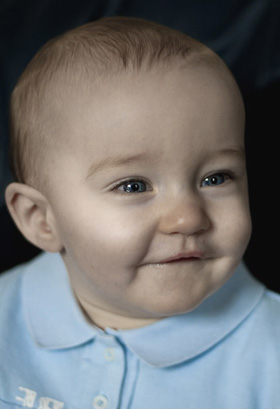 Close-up photo portrait of a baby using window light by Cathy Topping.