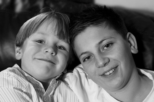 Close-up black and white photo portrait of two brothers by Cathy Topping.