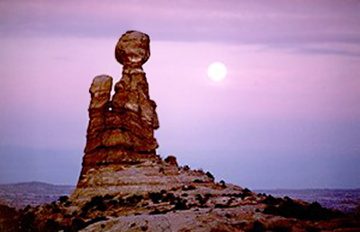 Full moon photography: sunset image of rock formations in front of full moon by Andy Long.