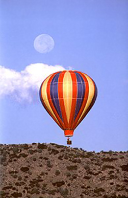 Full moon photography: early morning moon image with hot air balloon in the foreground by Andy Long.