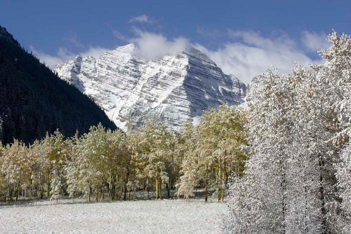 Photo of Maroon Bells, Aspen, Colorado with snow and fall colors by Andy Long
