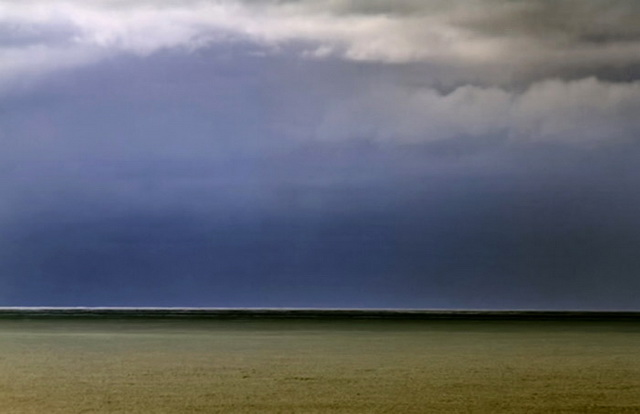 Photo of sky and ocean with unique colors by Noella Ballenger