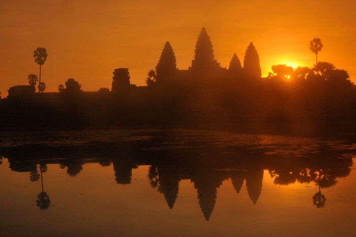 Silhouette photo of landscape reflected on water in Angkor Wat, Cambodia by Ron Veto