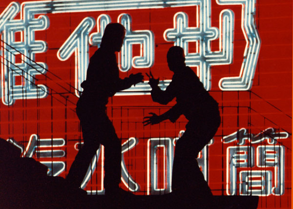 Silhouette photo of two men fighting at Hong Kong Island by Ron Veto