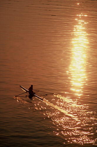 Silhouette photo of rower sculling on Potomac River in Virginia by Ron Veto
