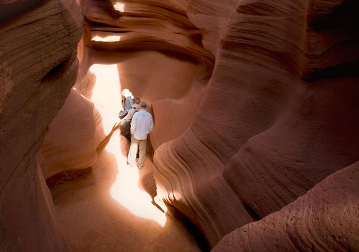 Photo of rock formations and people touring in the lower canyon of Antelope Canyon by Piero Leonardi