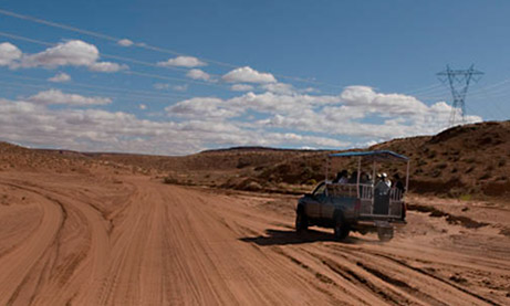 Photo of tourist vehicle used to take people to the upper canyon of Antelope Canyon by Piero Leonardi