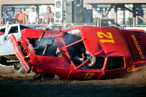 Stop action photography: Crashed cars at demolition derby by Brad Sharp.