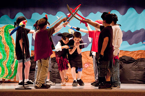 Stop action photography: Children perfoming in school play by Brad Sharp.