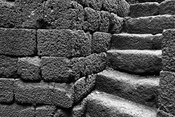 Photo of steps at holy well in the nuragic sanctuary Santa Vittoria, Serri, Cagliari by John Tollefsen