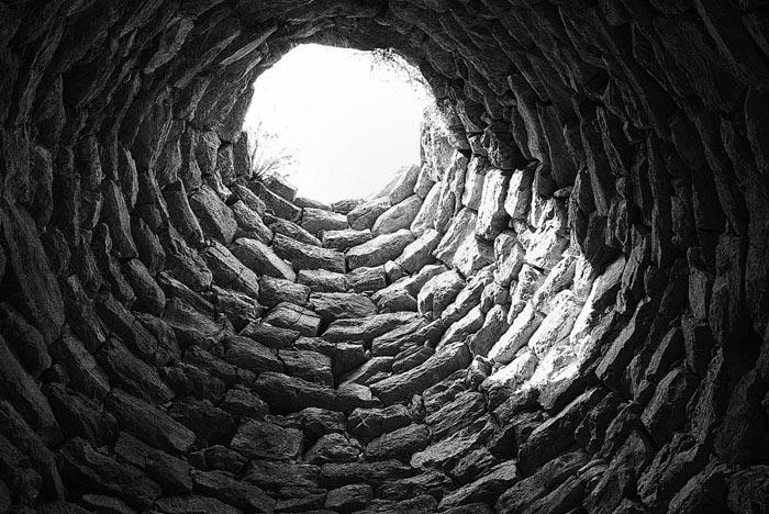 Photo of the upper part of the nuraghe Armungia forming an ellipse, Armungia, Cagliari by John Tollefsen