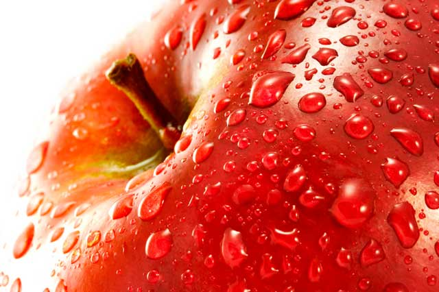 Macro photo of red apple with water drops from shutterstock.com.