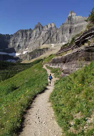 Photo adventures day hike: hiker on Rich Mountain Trail, Glacier Mountain National Park by Jeff Doran.