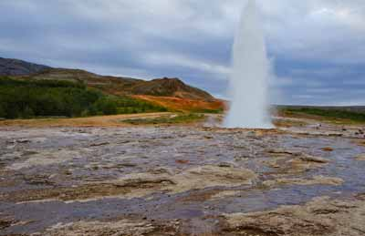 Photographic Travels in Iceland: Great Geysir erupting in the Haukadalur Valley by Michael Legerro.