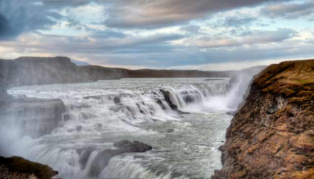 Photographic Travels in Iceland: Image of rushing waters of the Goðafoss Falls by Michael Legerro.