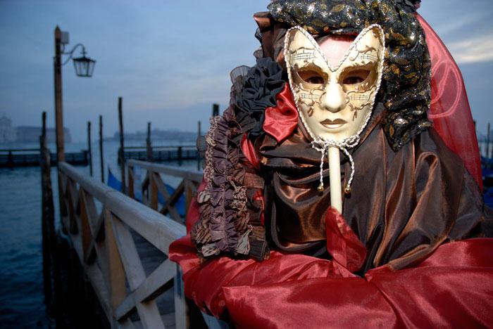 Photo of person in costume & mask at the Venice Carnival by Piero Leonardi