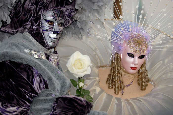 Photo of people in costumes & masks at the Venetian Carnival by Piero Leonardi