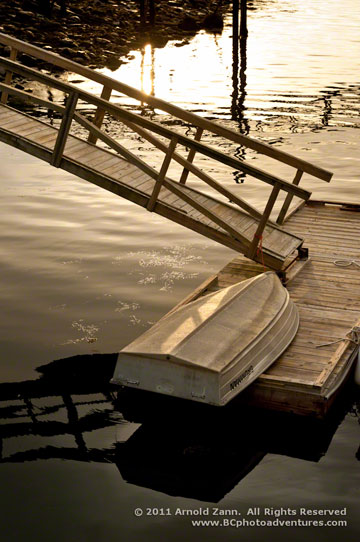 Photo of row boat on dock in mid-coast, Maine by Arnold Zann.