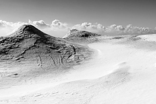 Black and white image of Canadian mountain peaks in the snow by Randall Romano.