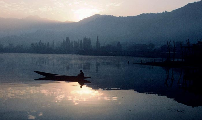 Photo of boat on Dal Lake in Kashmir, India by Ron Veto