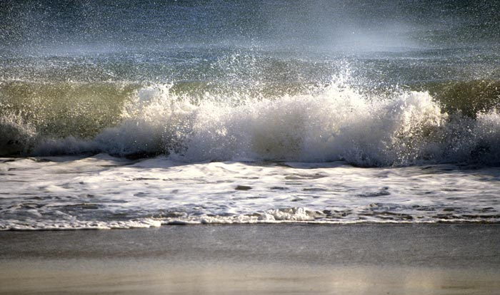 Photo of ocean wave and spray at the beach by Noella Ballenger
