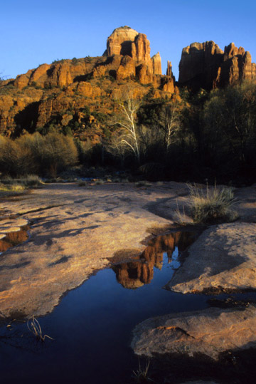 Reflection photo of rock formations in Sedona, AZ by Noella Ballenger