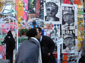 Photo of New York people on street and wall covered with graffiti art by Ned Harris.