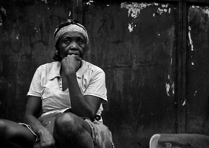 Tips for a Career in Photojournalism: Photo of unemployed woman in Port-au-Prince, Haiti by Michelle Wong