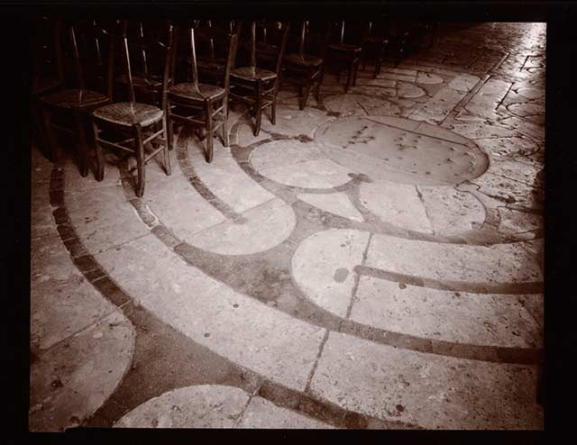 Black and white photo of a Maze in the stone floor at Chartres, France by Linda Connor.