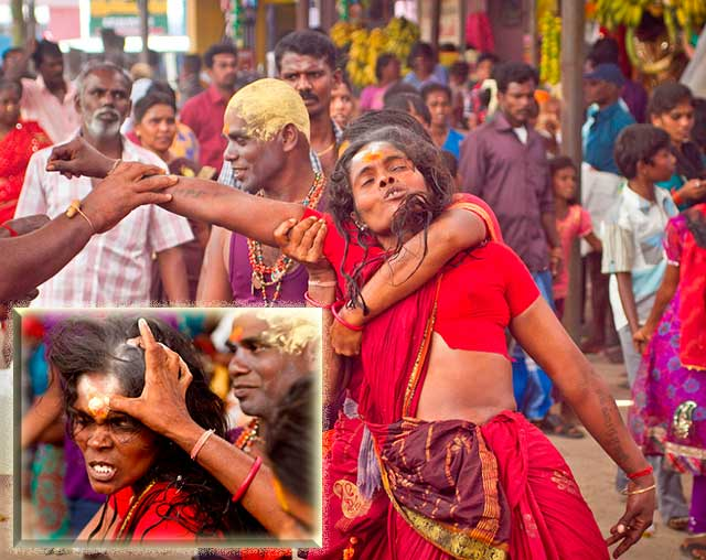 Dasara festival in India: women in red among the crowds is in a trance-like state by Kris Hariharan.